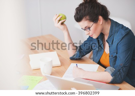 Attractive female worker is very busy - stock photo