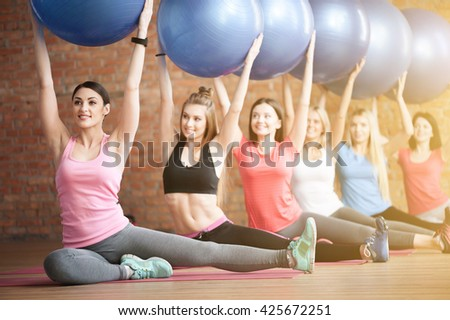 Attractive fit girls are doing exercise - stock photo