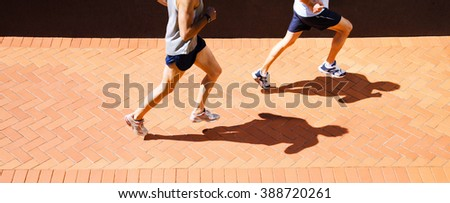 Attractive fit man running  - stock photo