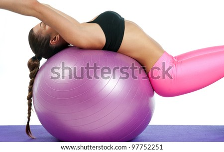 attractive fit woman on the pilates ball detail - stock photo