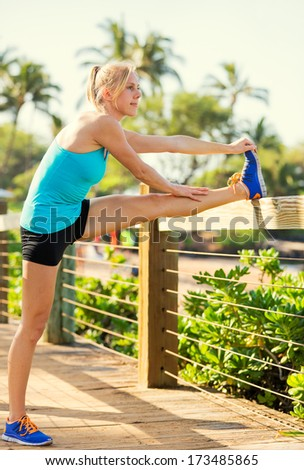 Attractive fit young woman stretching before exercise workout, Healthy lifestyle sports fitness concept.