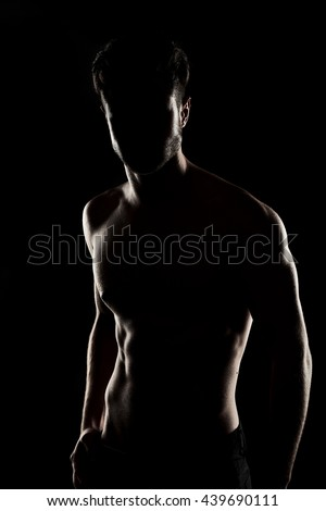 attractive fitness man, trained male body, lifestyle portrait, caucasian model. sexy fitness male model posing isolated on  black background. incognito - stock photo