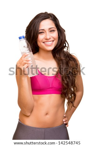 Attractive fitness woman holding a bottle of water