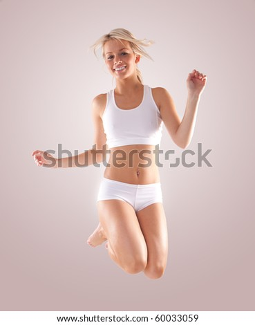 Attractive fitness woman jumping