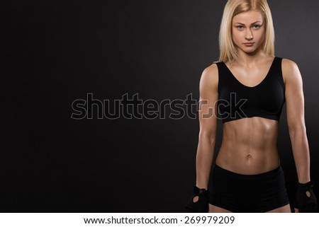attractive fitness woman, trained female body, lifestyle portrait - stock photo