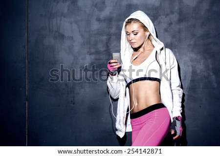 attractive fitness woman with mp3 player, caucasian model - stock photo