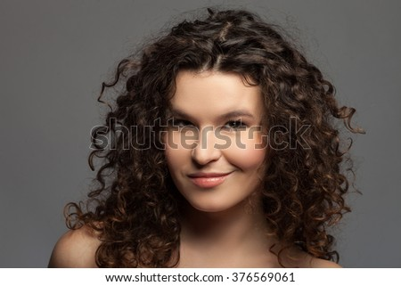 Attractive flirty woman is expressing her sexuality - stock photo