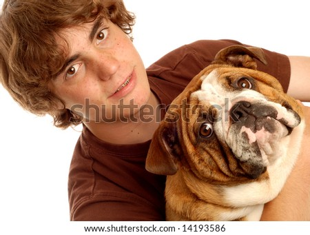 attractive fourteen year old boy and his bulldog puppy