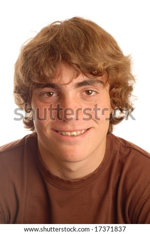 attractive fourteen year old boy with braces on his teeth - stock photo