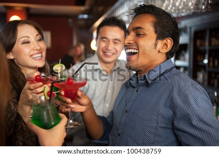 Attractive Friends at a bar - stock photo