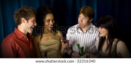 Attractive friends at a club drinking - stock photo