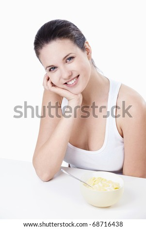 Attractive girl at breakfast on a white background - stock photo