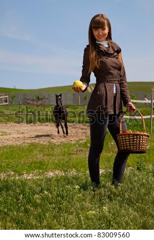 attractive girl basket of apples in the hands. outdoor shot