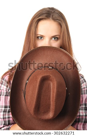 Attractive girl covering face with cowboy hat - stock photo
