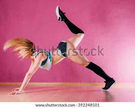 Attractive girl dancing booty dance studio stock photo for Dance where you sit on the floor