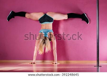 Attractive girl dancing twerk studio sitting stock photo for Dance where you sit on the floor