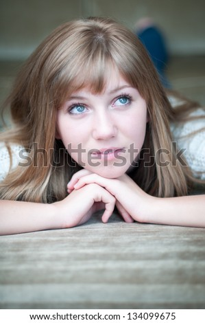 Attractive girl day dreams on the couch - stock photo