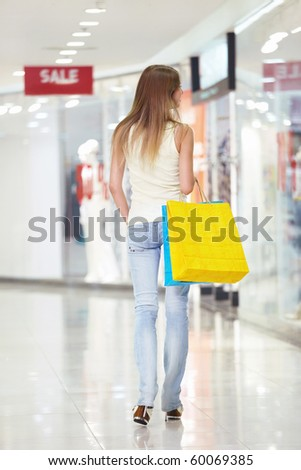 Attractive girl goes to the store - stock photo