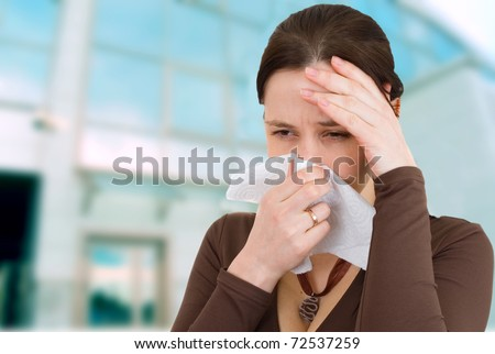 Attractive girl got a cold - stock photo