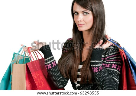 Attractive girl holding gift bags - stock photo