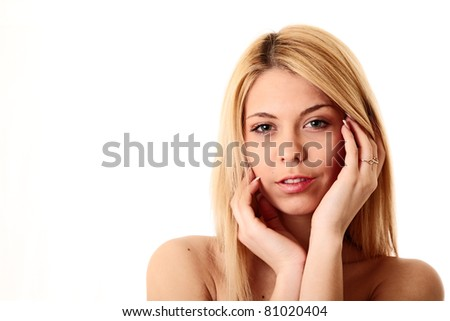 attractive girl holding hands on face. studio shot