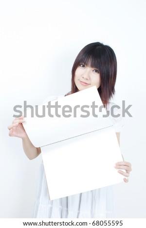 attractive girl holding sketchbook - stock photo