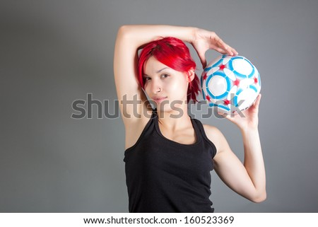 attractive girl holding soccer ball - stock photo