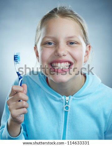 Attractive girl holding toothbrush - stock photo