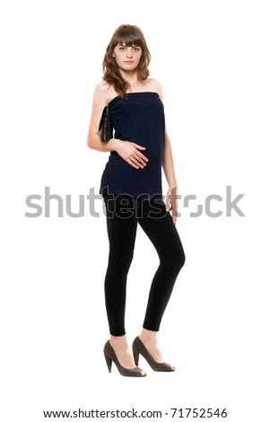 Attractive girl in a black leggings. Isolated on white