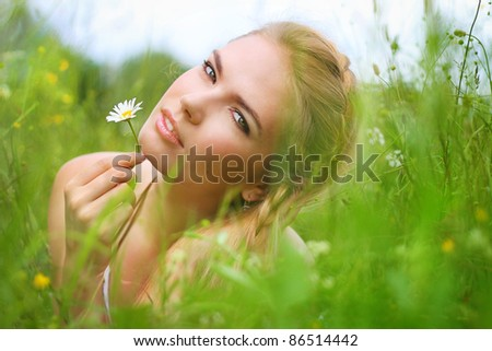 attractive girl in a field