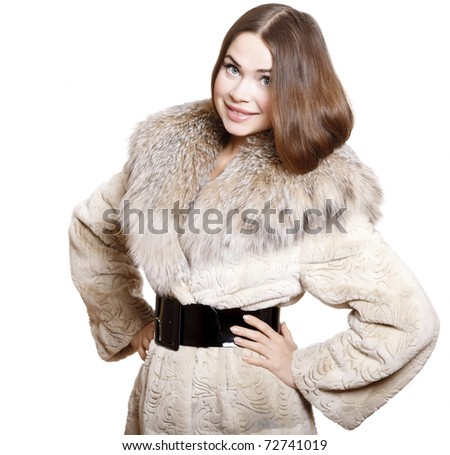 attractive girl in a fur coat, isolated on white background - stock photo