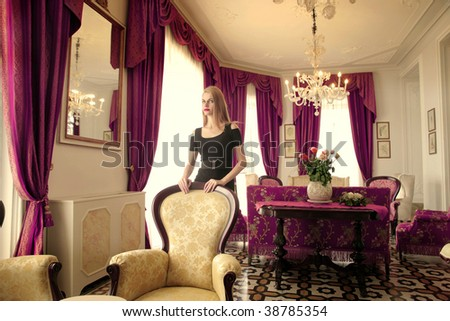 attractive girl in a luxury interior - stock photo