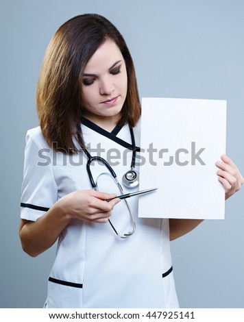 attractive girl in a medical uniform with a pencil points to the poster