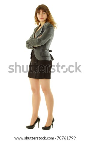 attractive girl in a short black skirt in a confident pose standing on white background - stock photo