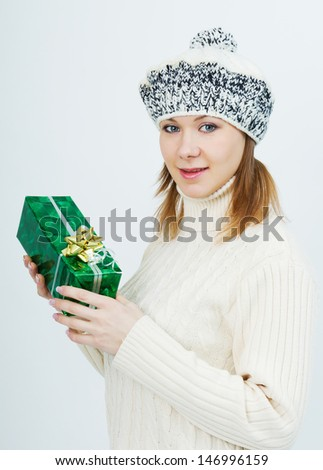 attractive girl in a sweater with a gift in their hands - stock photo