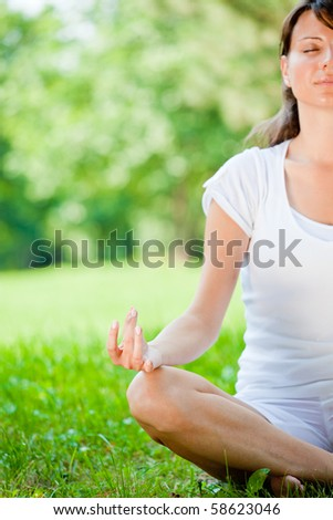 Attractive girl in one of the yoga postures - stock photo