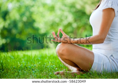 Attractive girl in one of the yoga postures