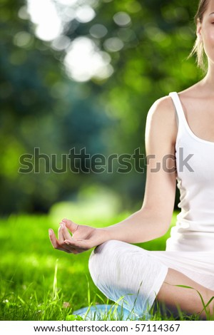 Attractive girl in one of the yoga postures close up - stock photo