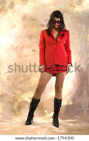 Attractive girl in red clothes and sunglasses