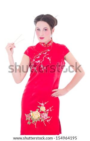 attractive girl in red japanese dress with chopsticks isolated on white background - stock photo