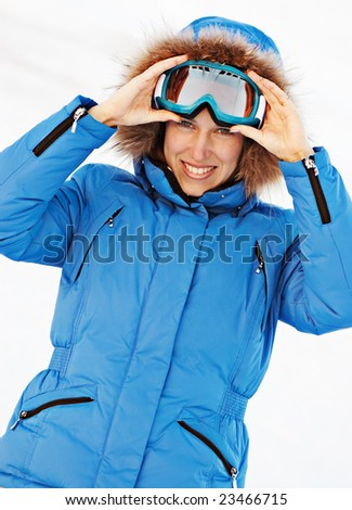 attractive girl in ski sunglasses over white background