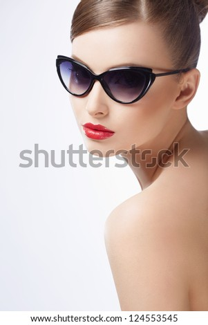 Attractive girl in sunglasses on a white background - stock photo