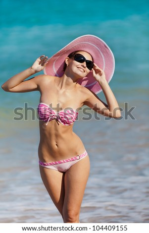 Attractive girl in swimwear at the sea. Young woman posing on seashore - stock photo