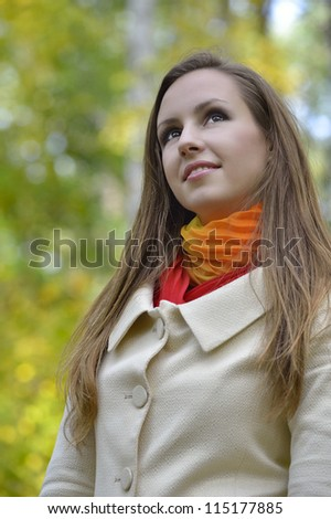 Attractive girl in the autumn park