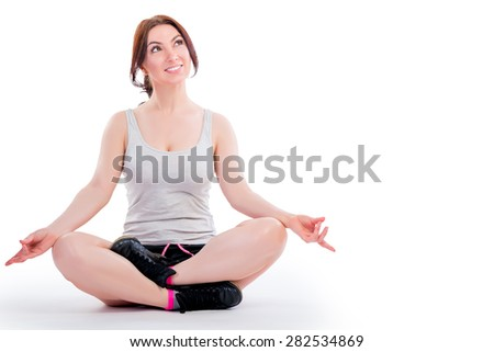 attractive girl in the lotus position on a white background - stock photo