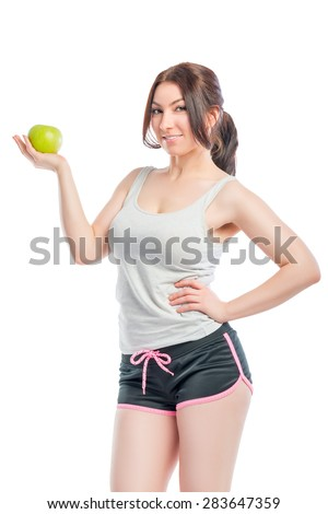 attractive girl in the sports form with green apple - stock photo