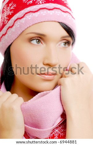 Attractive girl in winter hat and scarf . Isolated on white.