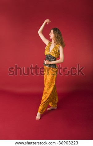 attractive girl in yellow dress at dance - stock photo