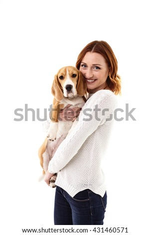 Attractive girl is hugging her loving puppy - stock photo