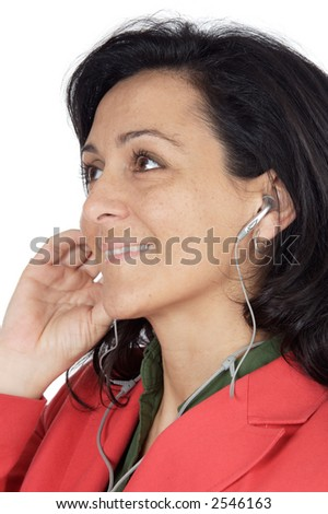 attractive girl listening music with earpieces a over white background